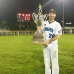 Craig Crawford of Hill United Chiefs with trophy his game-winning hit earned. (click to enlarge)
